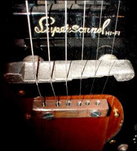 Close up of an electric guitar pickup by Supersound